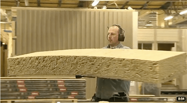 man carrying large rectangular piece of mineral wool
