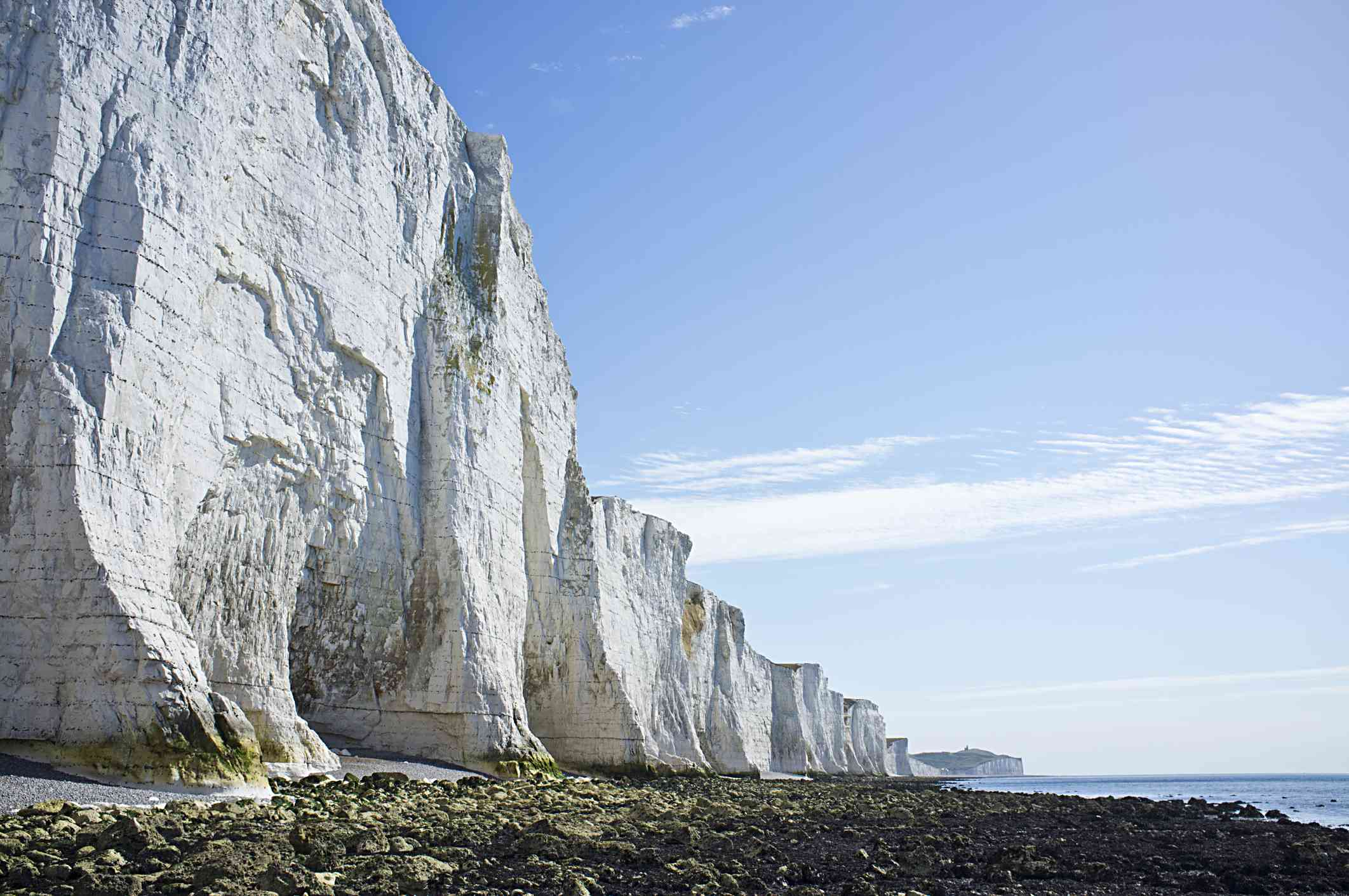The chalky White Cliffs of Dover rise above the waters on the English coast