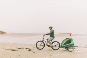 family bike ride on a beach