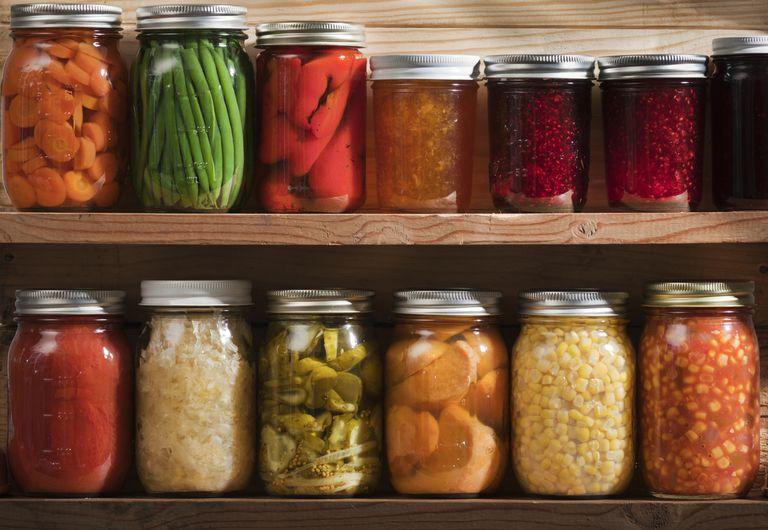 Pickled Food Stored on Wooden Storage Shelves