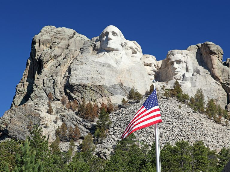 U.S. flag flying in front of Mount Rushmore