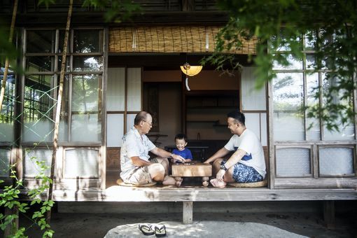 Japanese family playing on porch