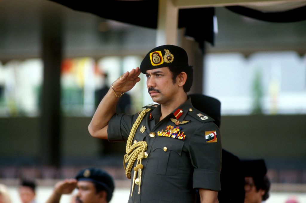Sultan of Brunei, Hassanal Bolkiah, saluting at an event