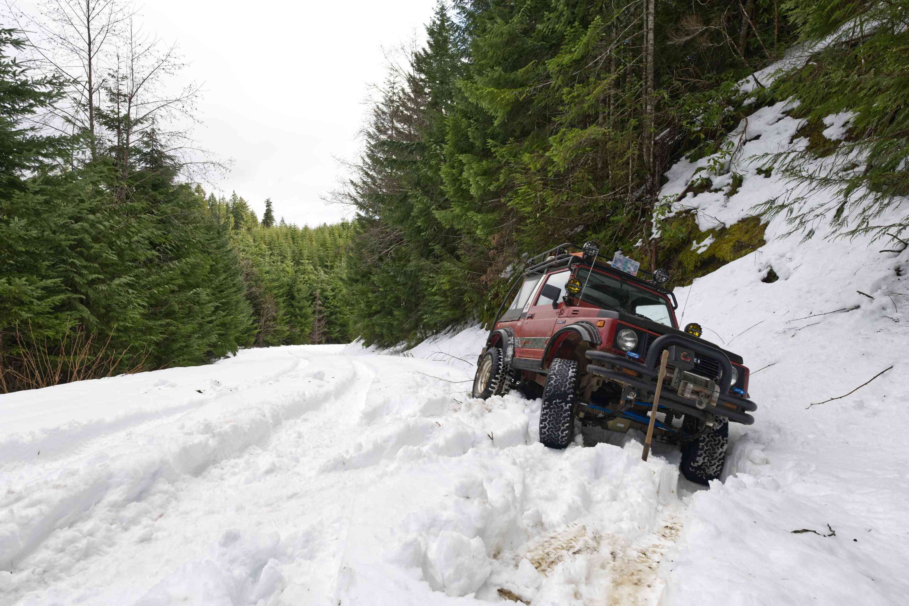 big jeep stuck in snow bank on mountain