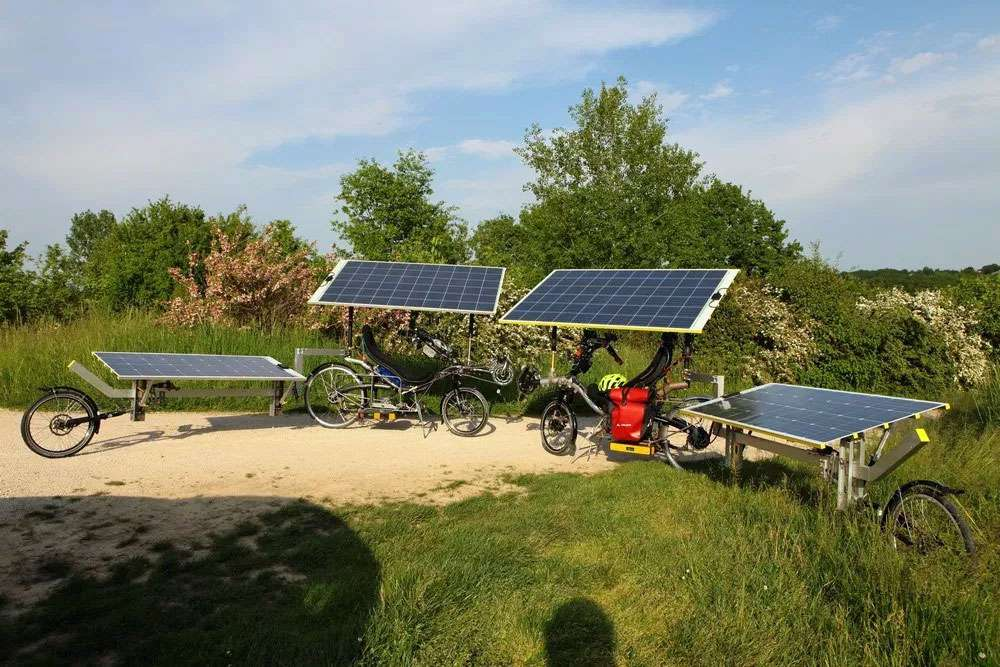 Two bikes with several solar panels
