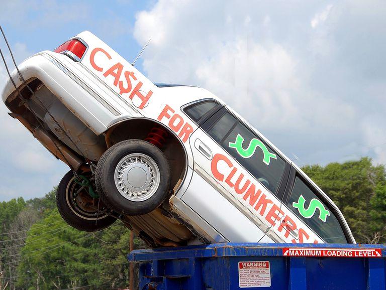 A car sticking out of a trash bin