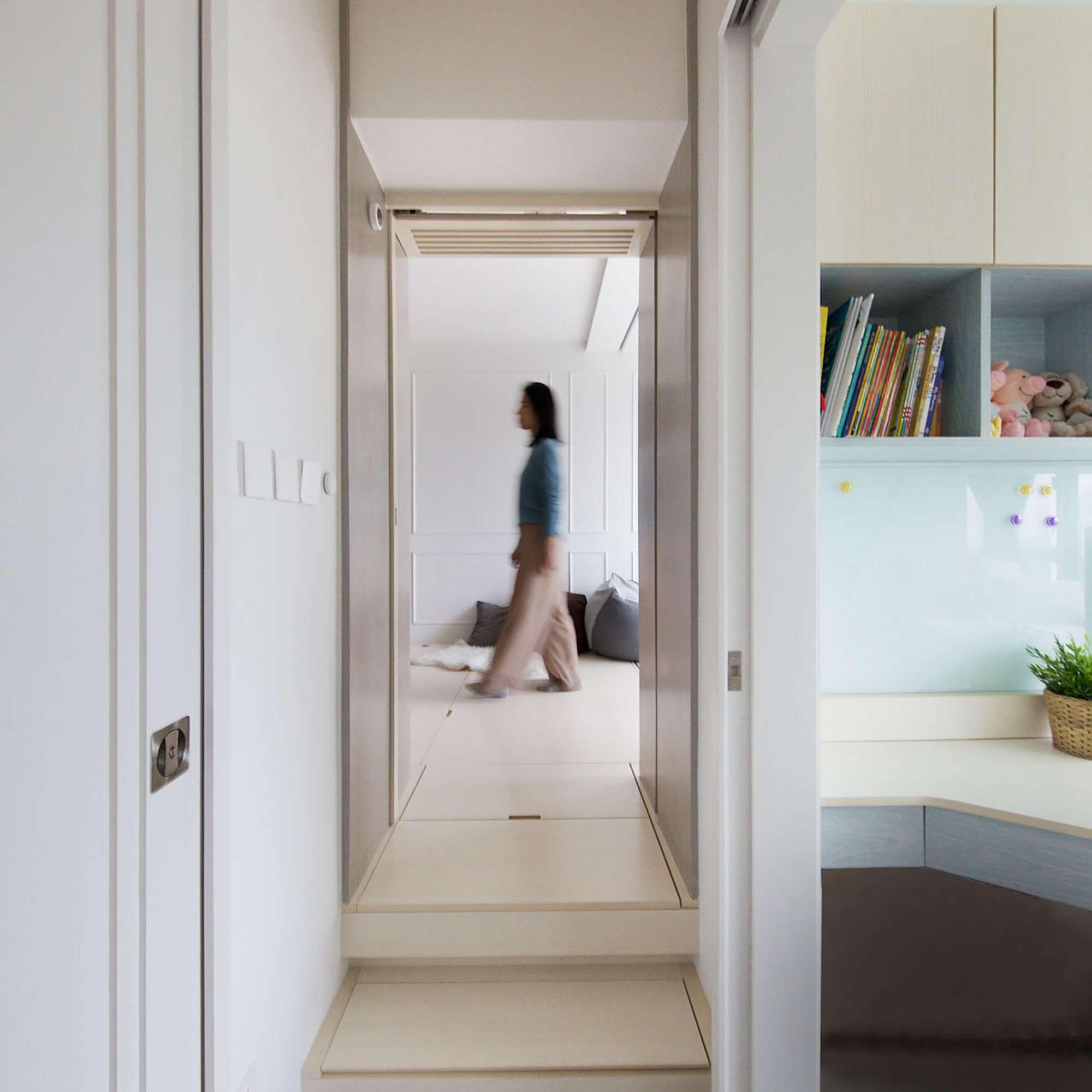 Smart Zendo micro-apartment by Sim-Plex Design Studio steps going up into living room