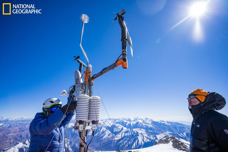 Baker Perry, right, and another expedition teammate install the weather station in Chile.