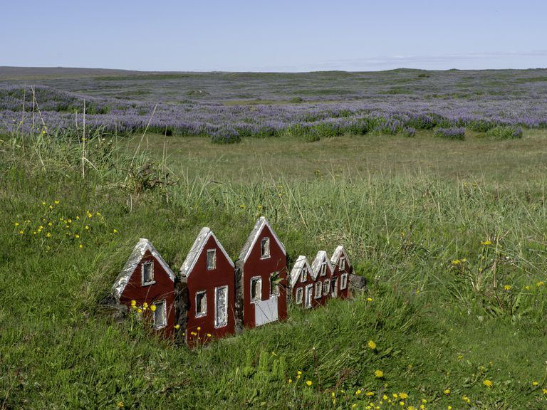 Little red elves houses in the side of a hill in Iceland