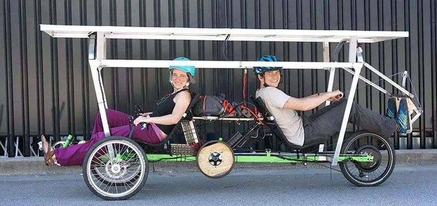 Tandem bike where riders are facing opposite directions