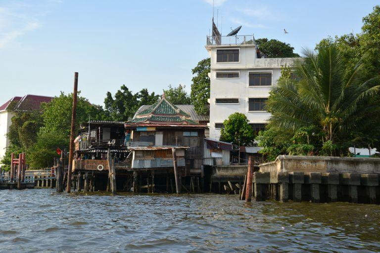 Stilt houses on a river in Bangkok, Thailand.