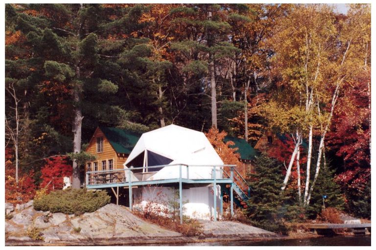 Dome at a cabin on Shoe Lake, surrounded by multicolored trees