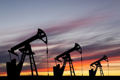 Oil pump on a sunset background. World Oil Industry
