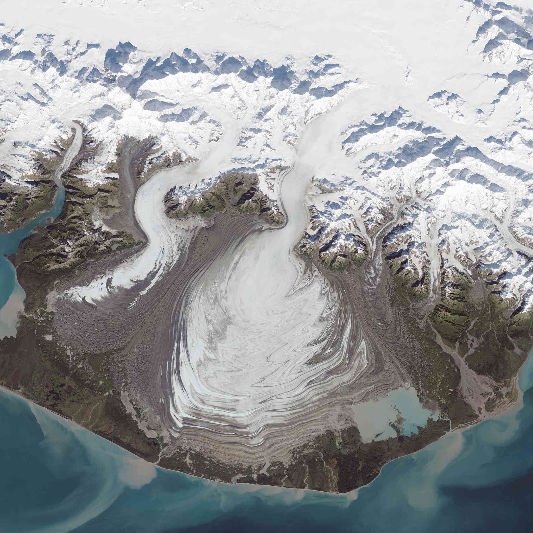 A piedmont glacier is one that spreads out into a wide