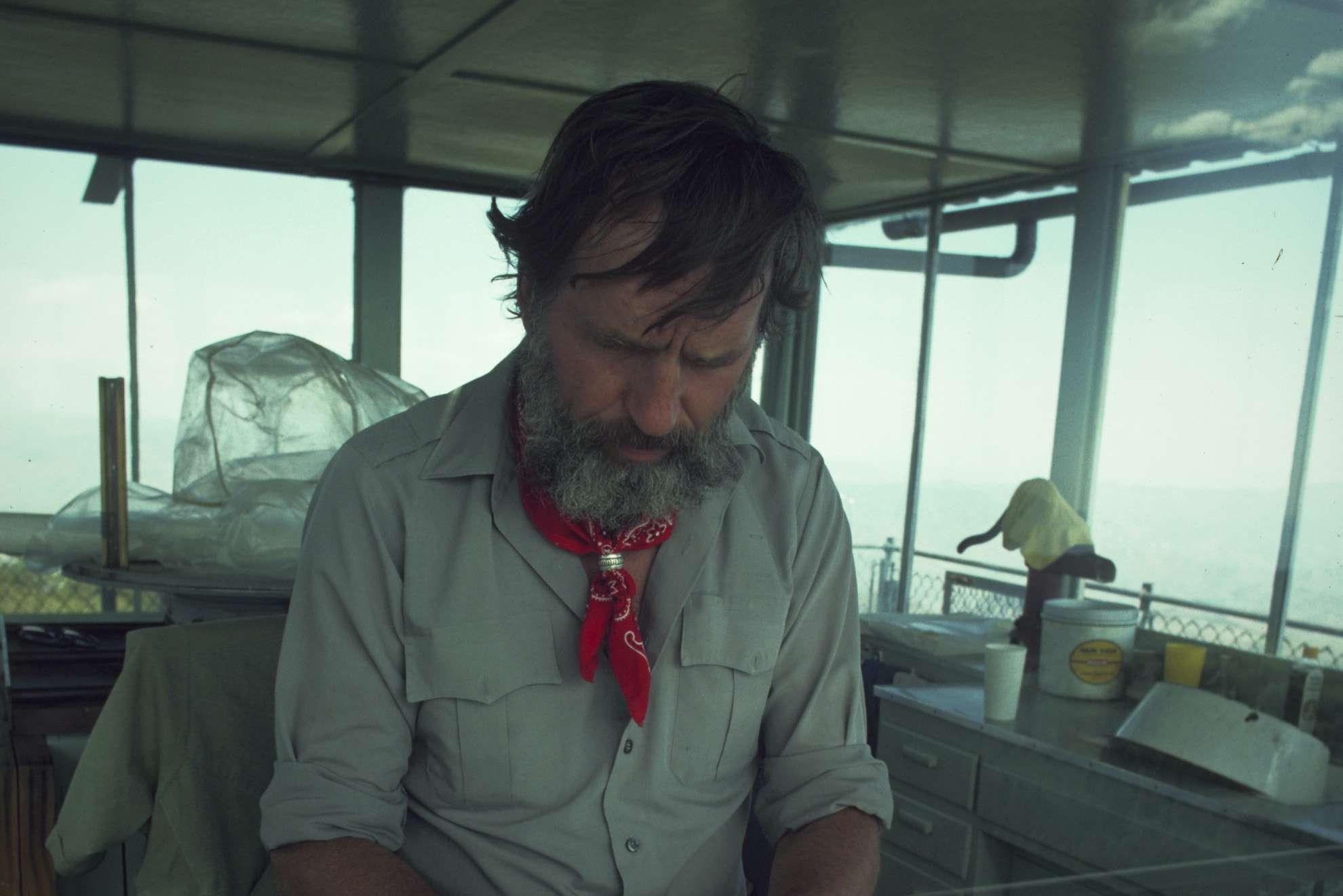 Novelist Edward Abbey at work on a boat