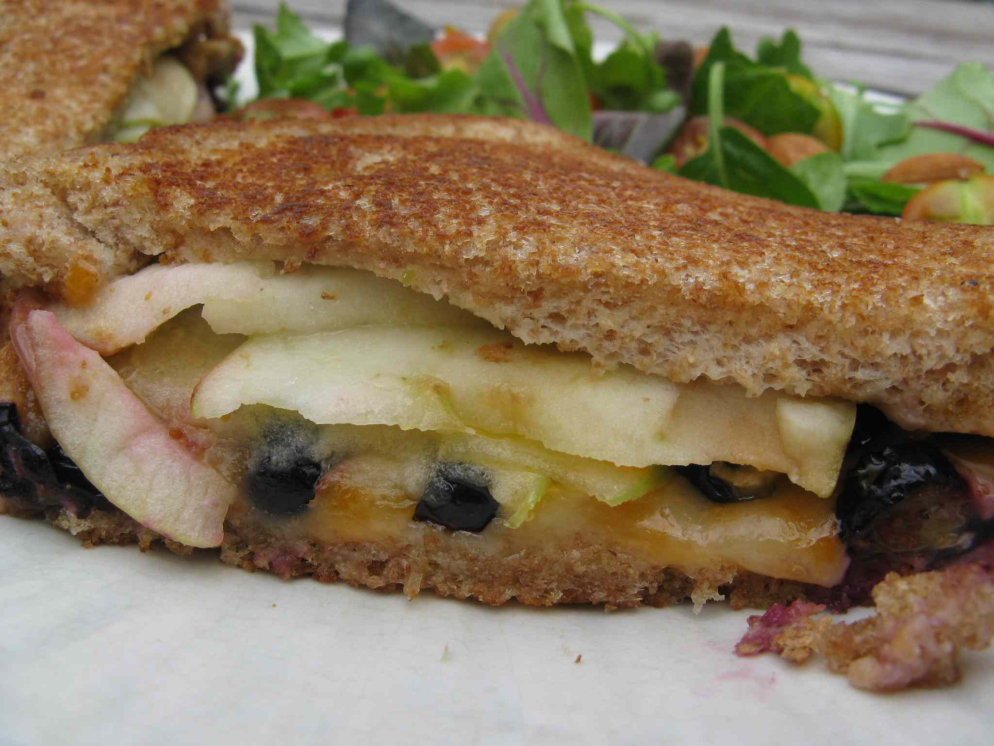 Grilled cheese sandwich with blueberries and apple