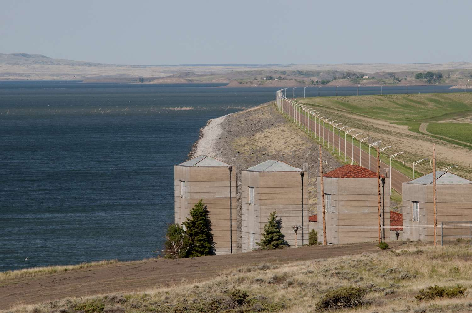 Fort Peck Dam stretches into the distance as it holds back the water of the great Missouri River