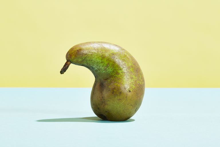 Misshapen pear sitting on a table