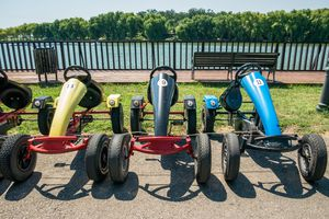 Quadricycles lined up next to a riverfront