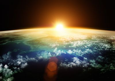 picture from the upper atmosphere of the sun rising over earth