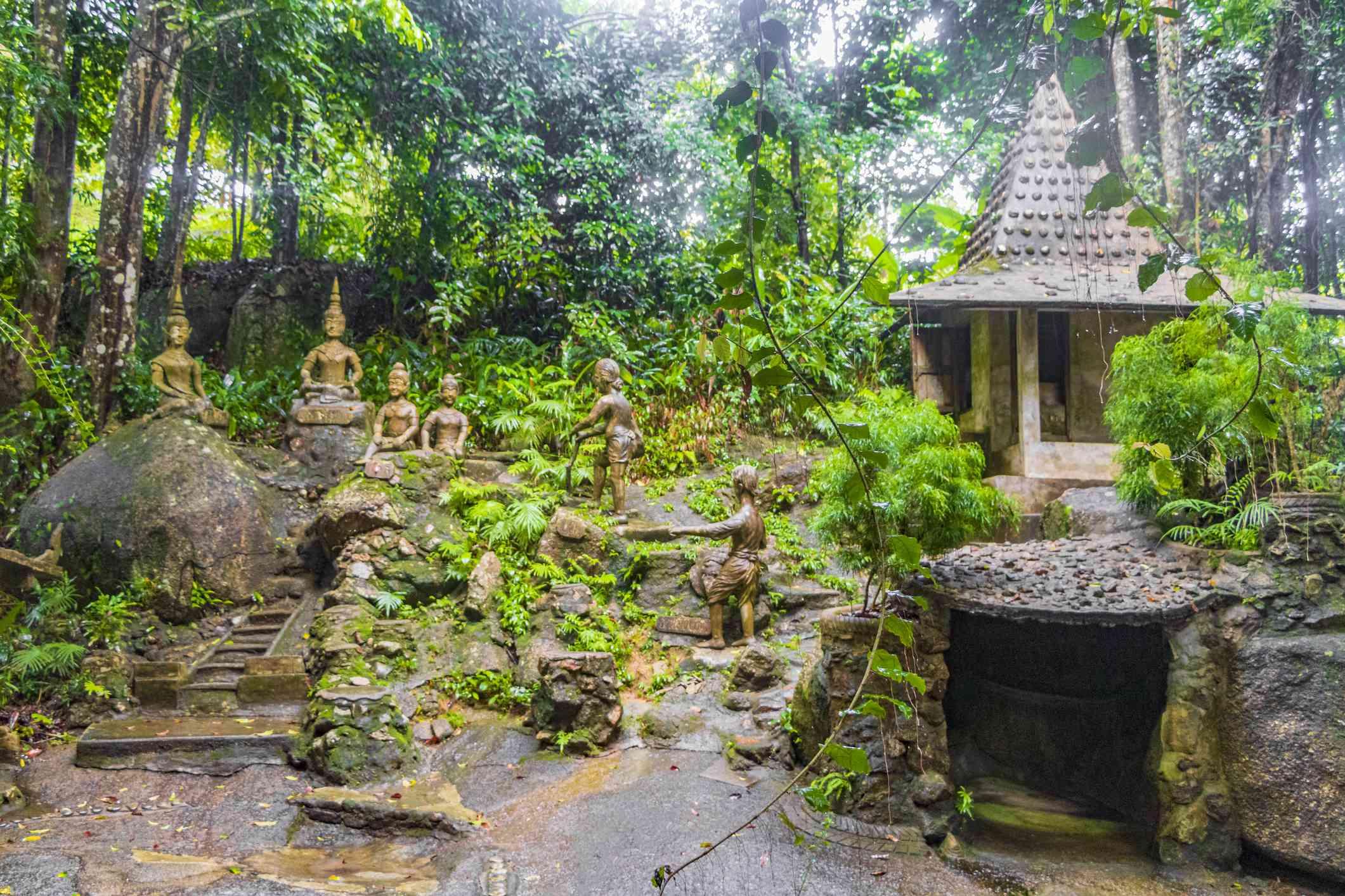 Buddha statues and waterfall at Tarnim Magic Garden, Thailand