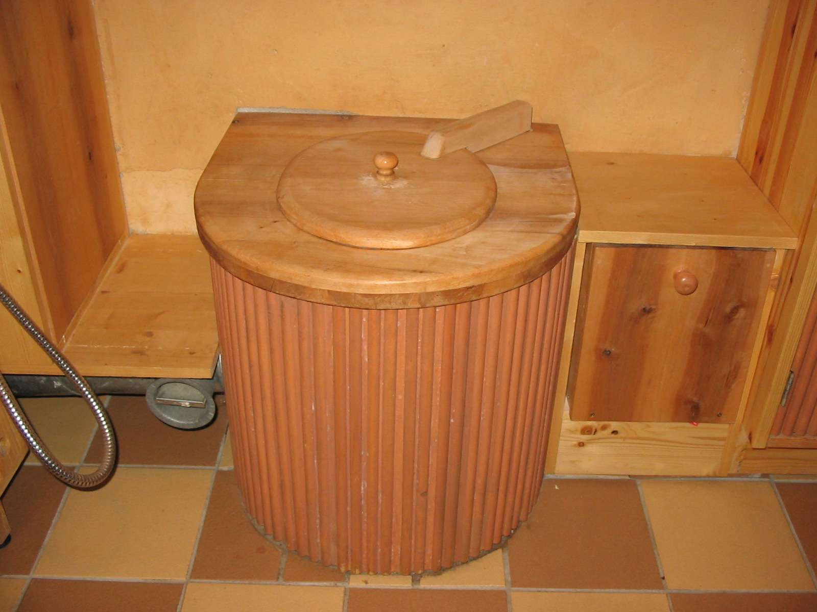 A composting toilet in a wood washroom.