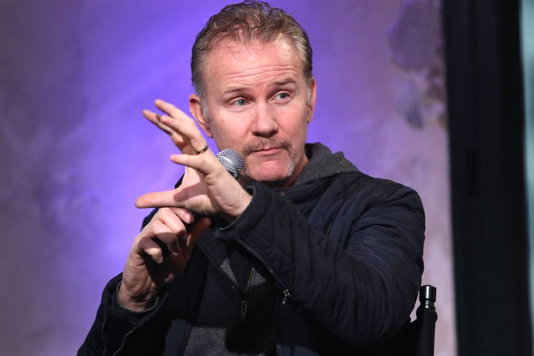 Producer Morgan Spurlock talking with a mic in his hand on stage.