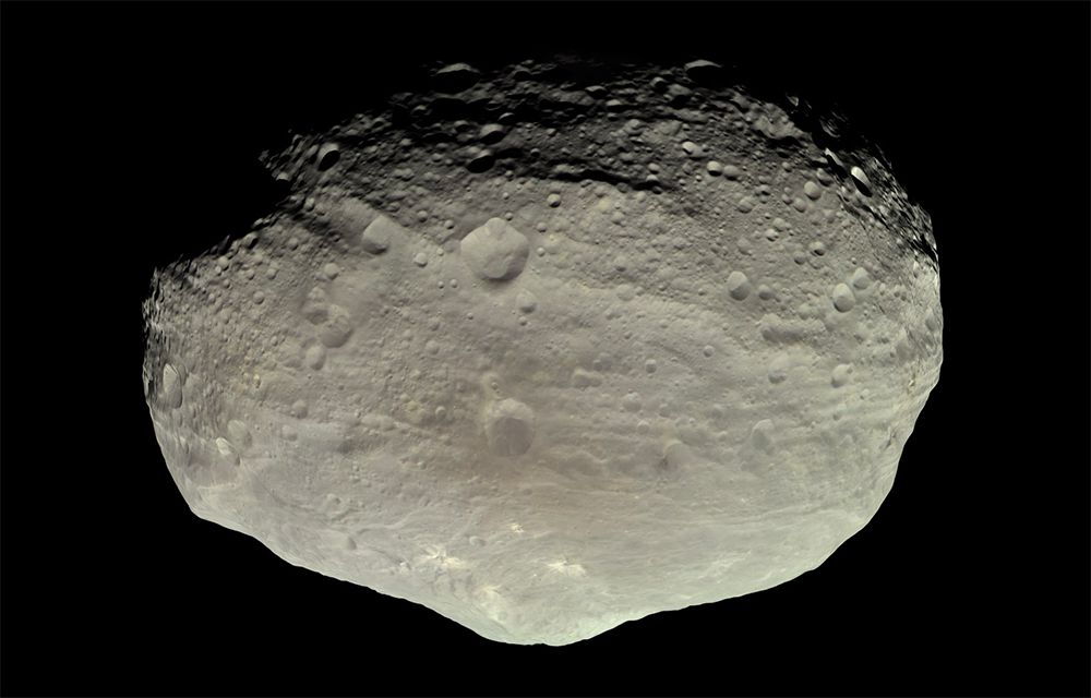 A true color image of Vesta's surface as captured by the Dawn space probe at a distance of 3,200 miles in July 2011.