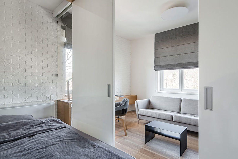 man's lair micro apartment boq architekti view from bed
