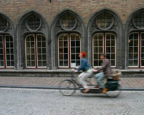 Action image of two people riding a bicycle