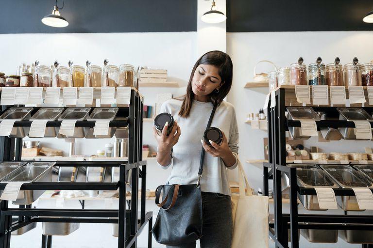 woman looking at glass jars