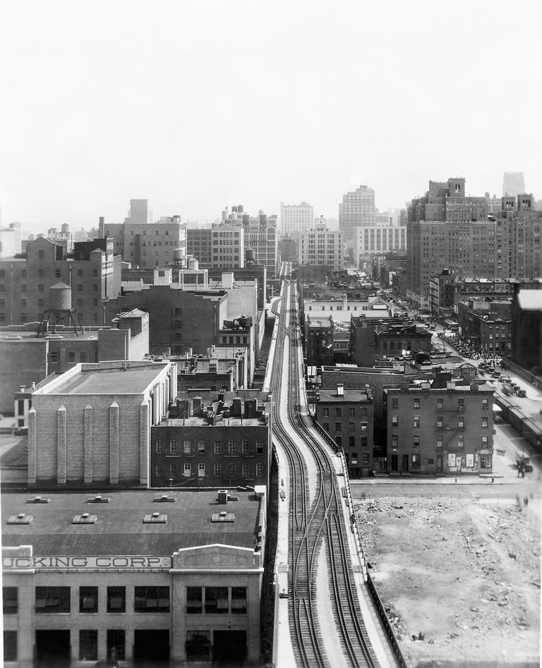 Black and white photo of a city landscape with skyscrapers