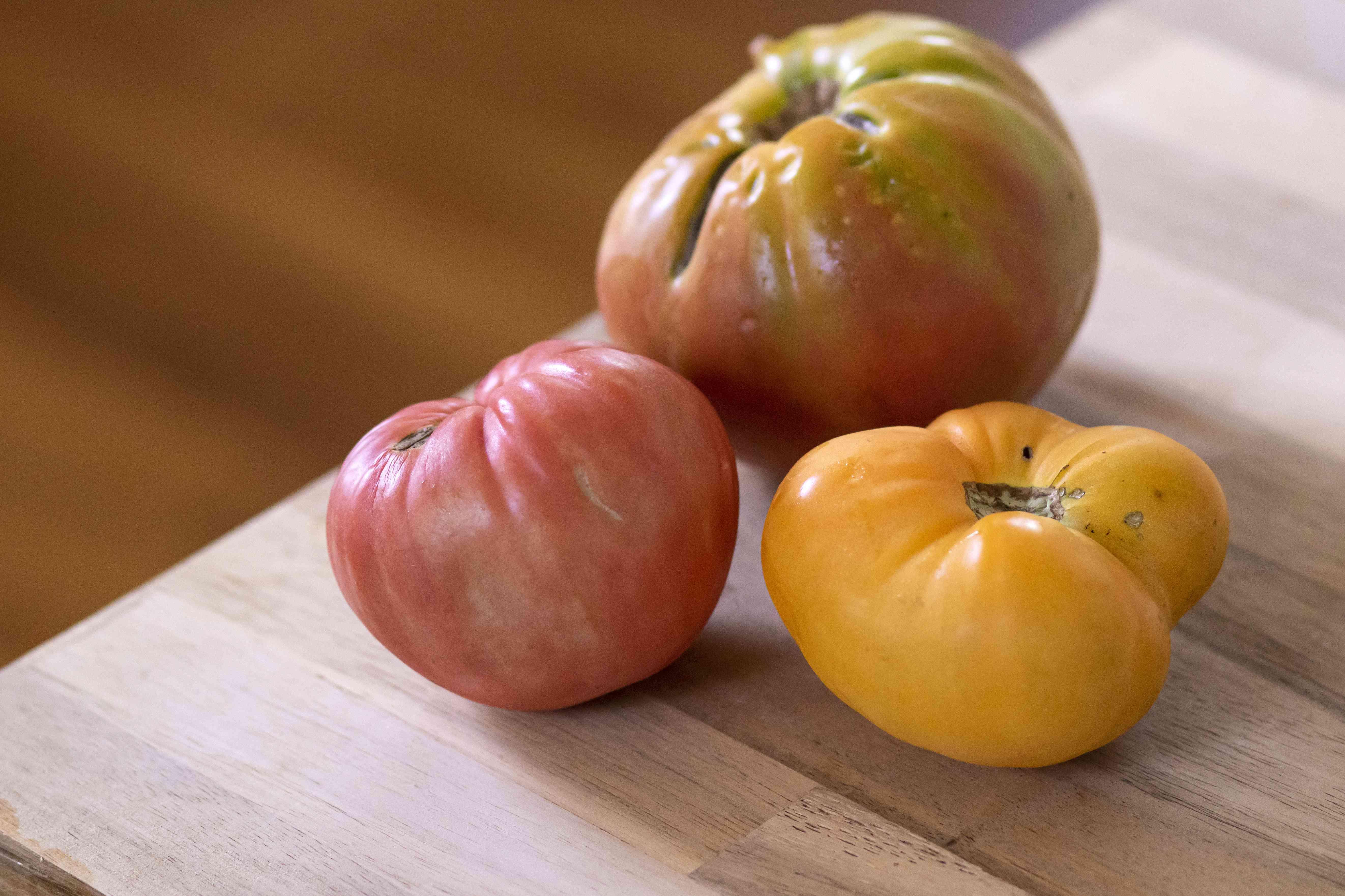 three heirloom tomatoes