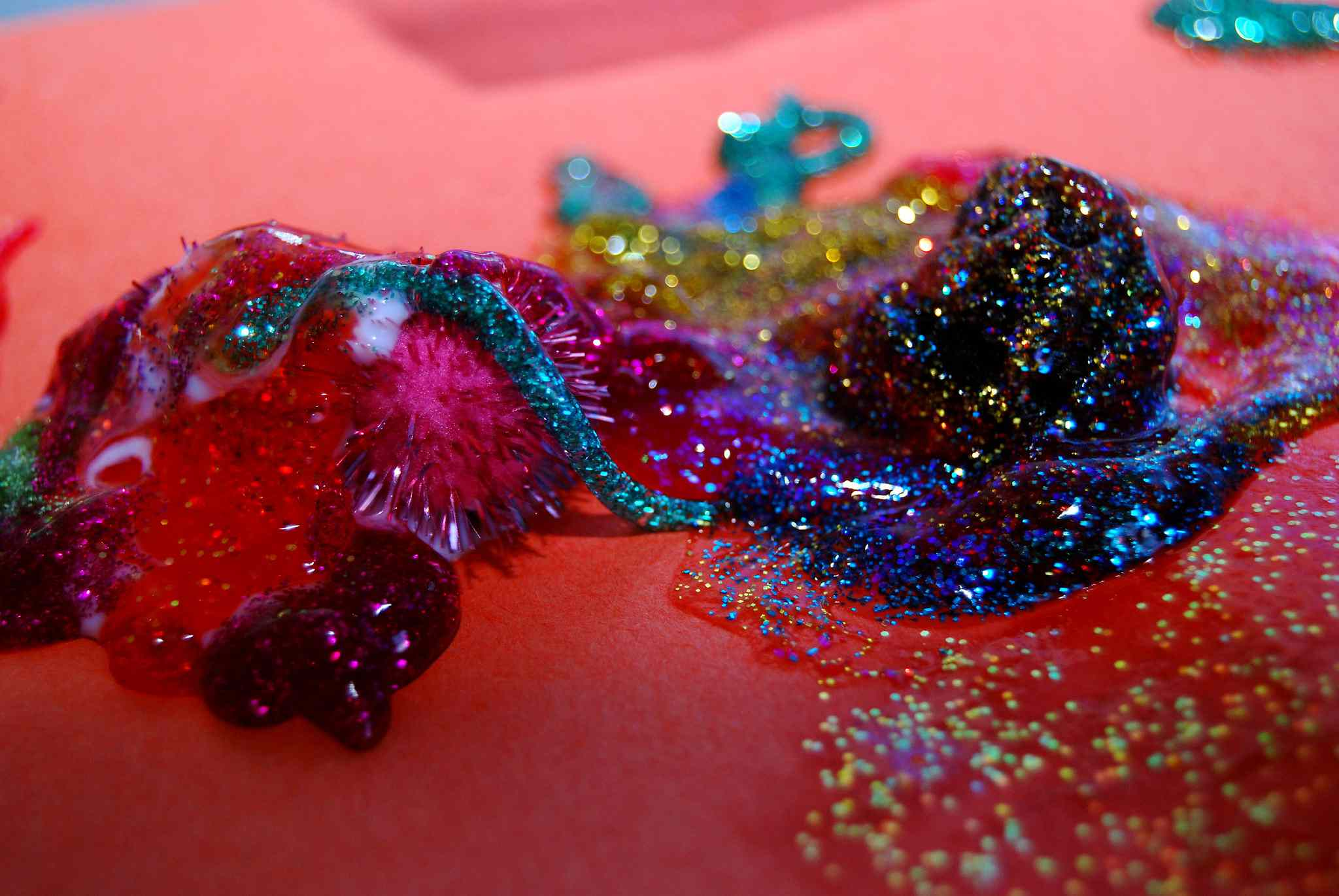 Close-up of different colors of glitter glue on paper