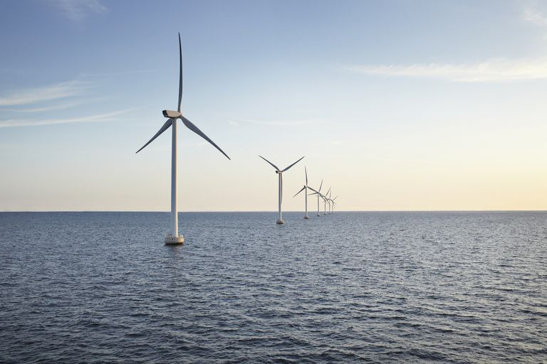 Row of wind turbines in the ocean