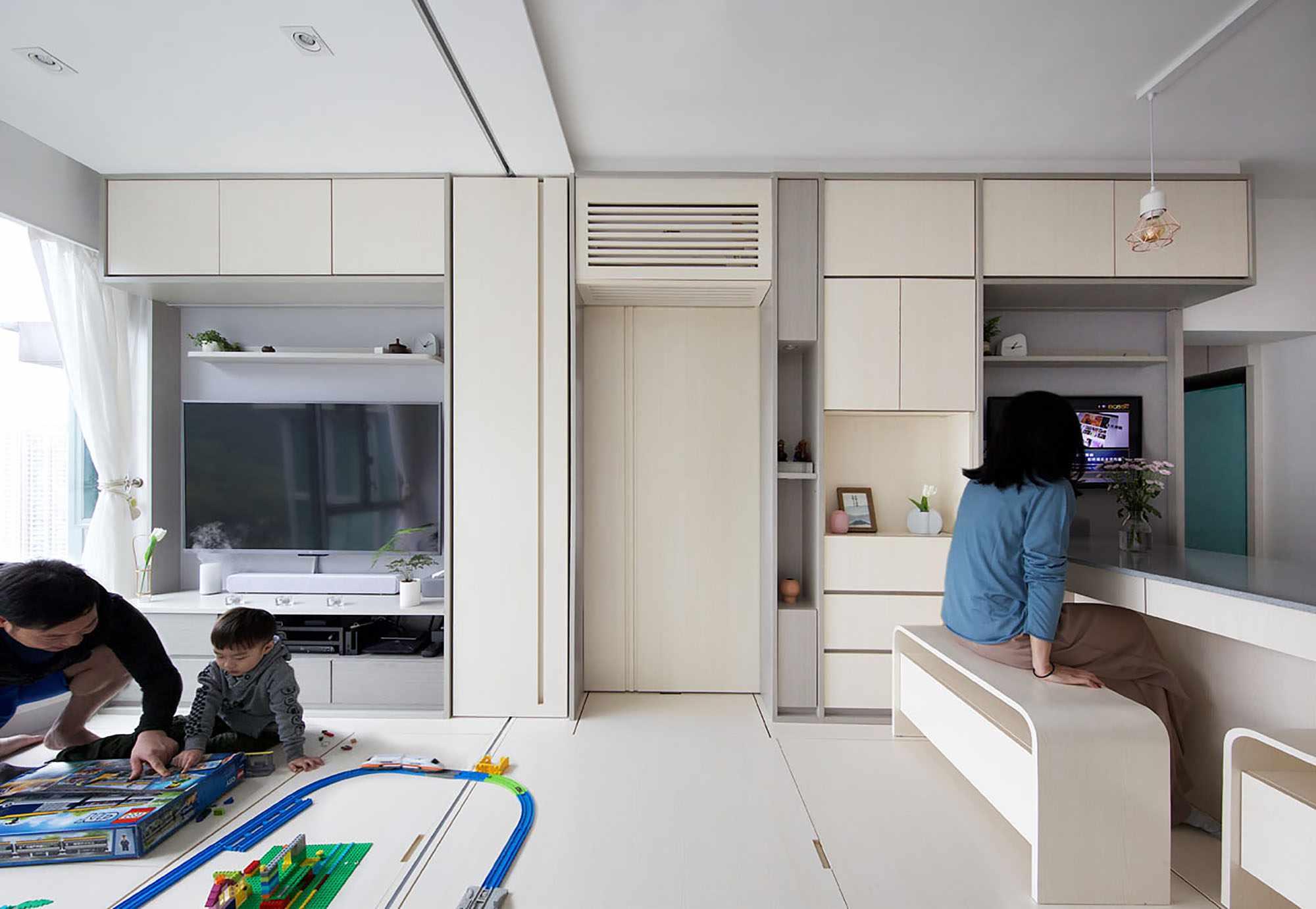 Smart Zendo micro-apartment by Sim-Plex Design Studio living room and kitchen