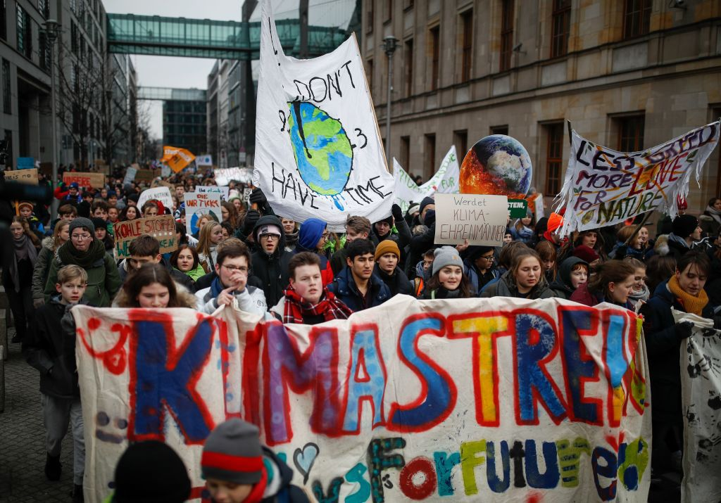 Students walk with banners and placards during the 'Fridays for Future' protest