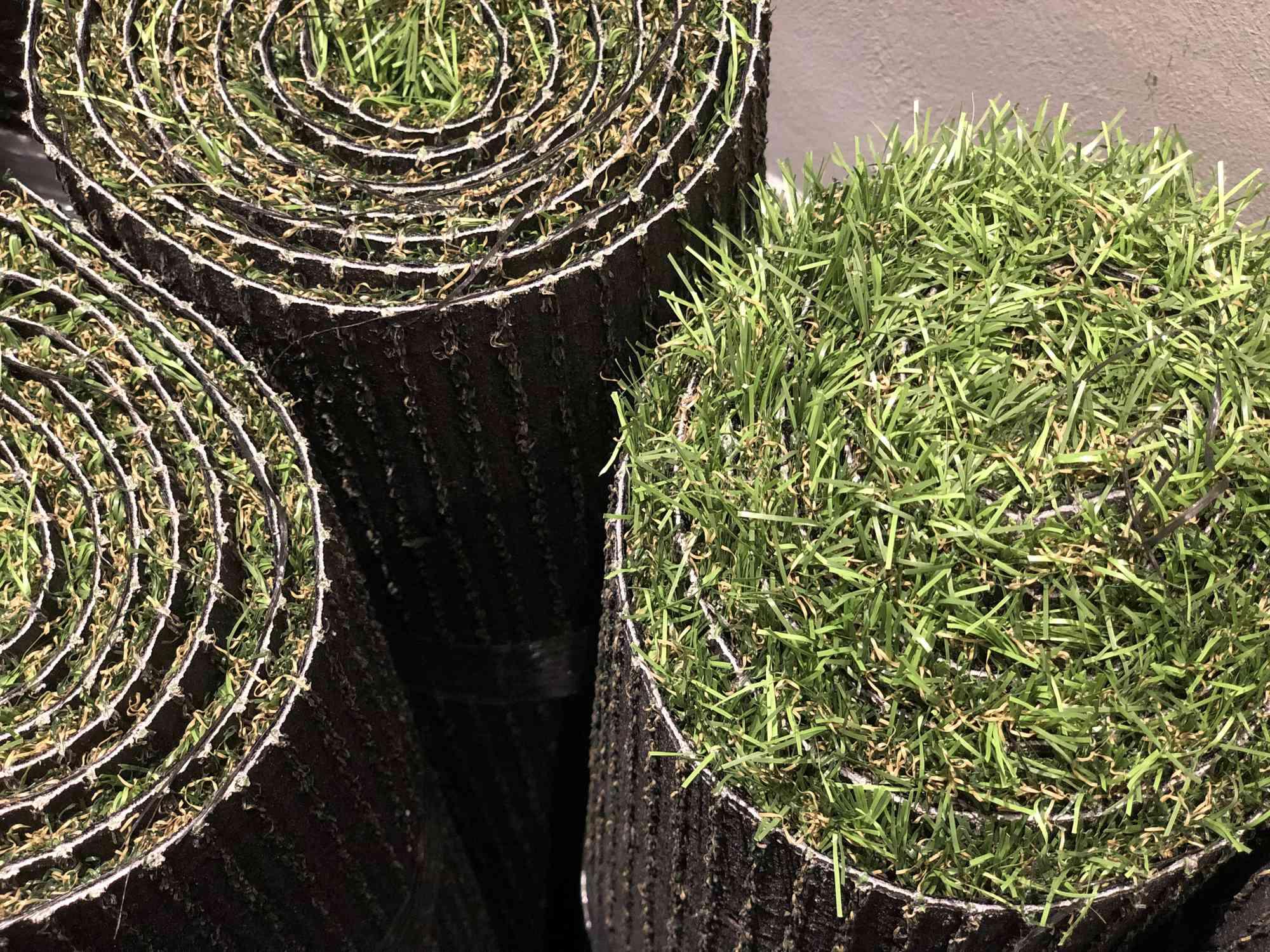 Aerial shot of artificial grass rolls.