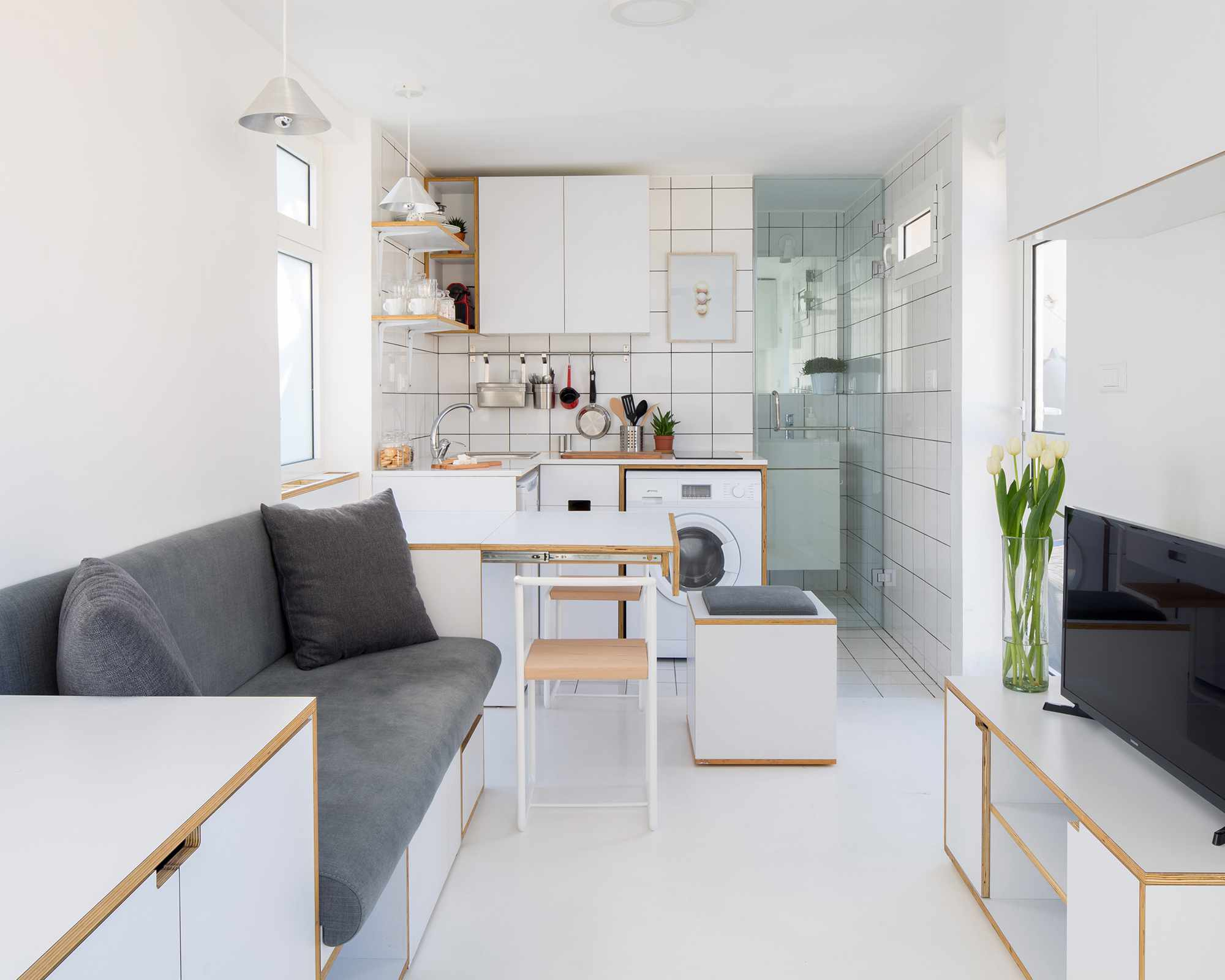 The Shoebox micro-apartment by Elie Metni expanded dining table