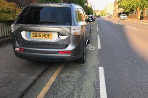 Outlander blocking bike lane and sidewalk in Edinburgh