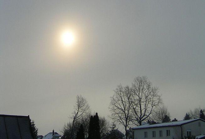 Sun peeks through an altostratus cloud