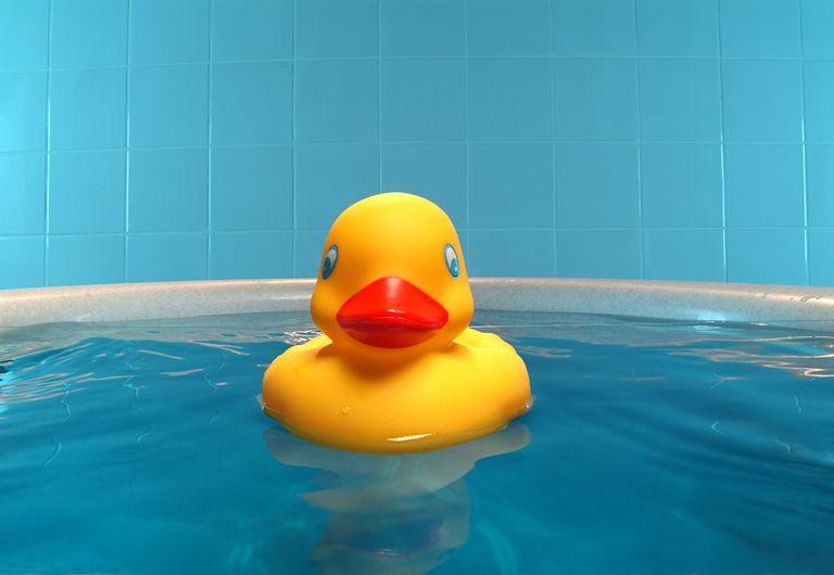 rubber duck floating in a bathtub