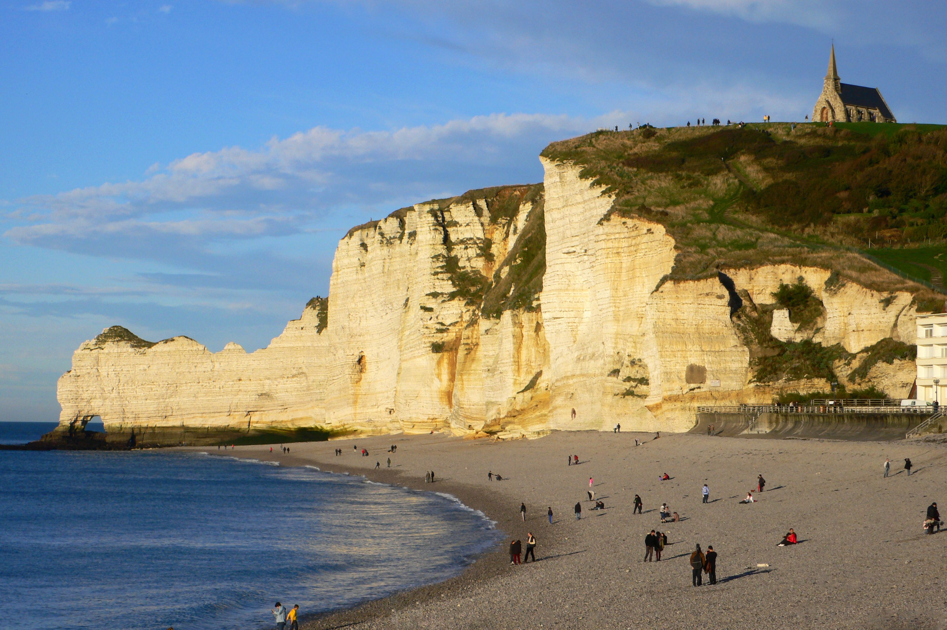 The white face of the cliffs at Étretat, France on a sunny day
