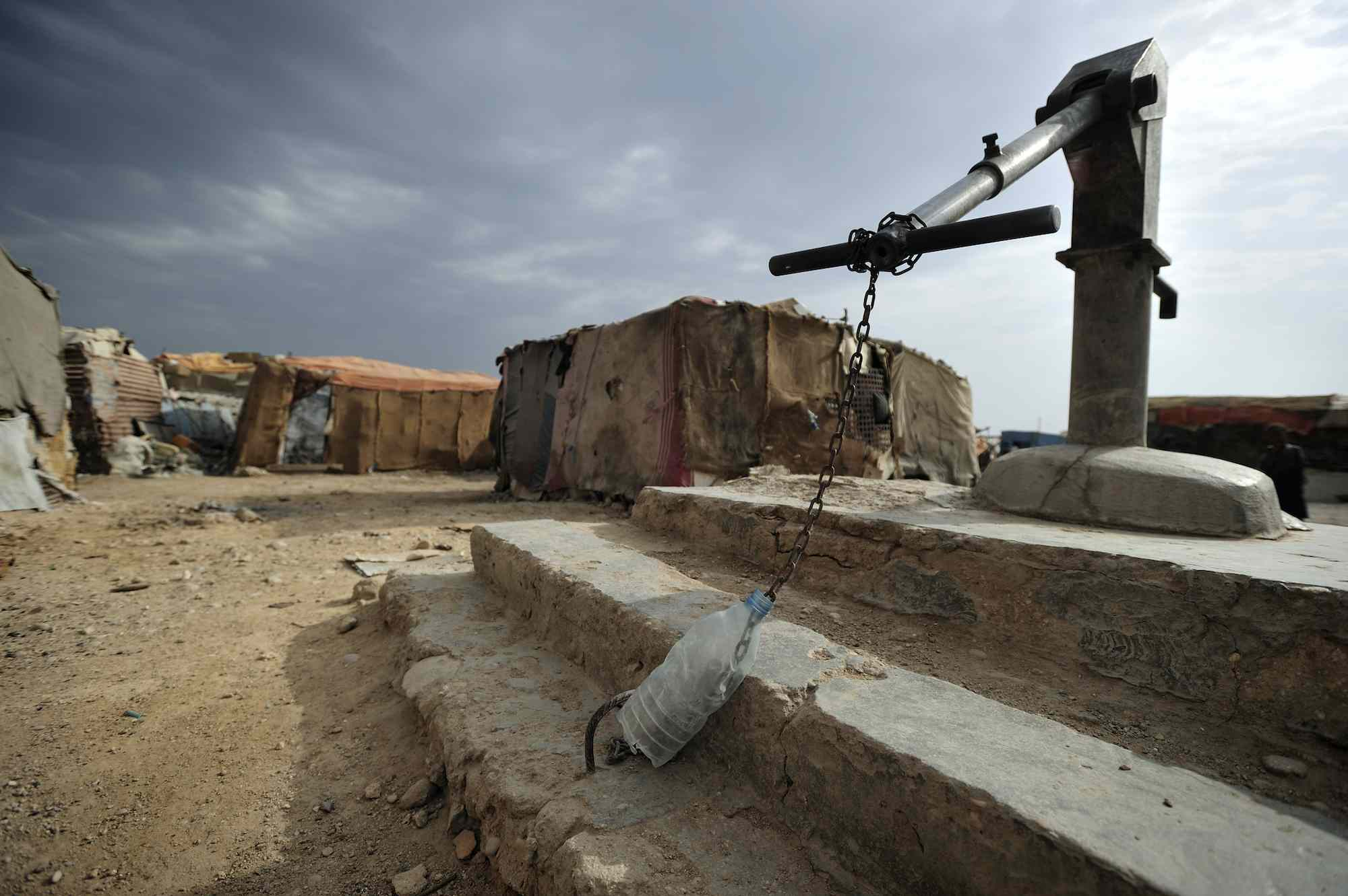 An IDP camp in Somalia's Puntland region, with a locked well where people are forced to pay for water