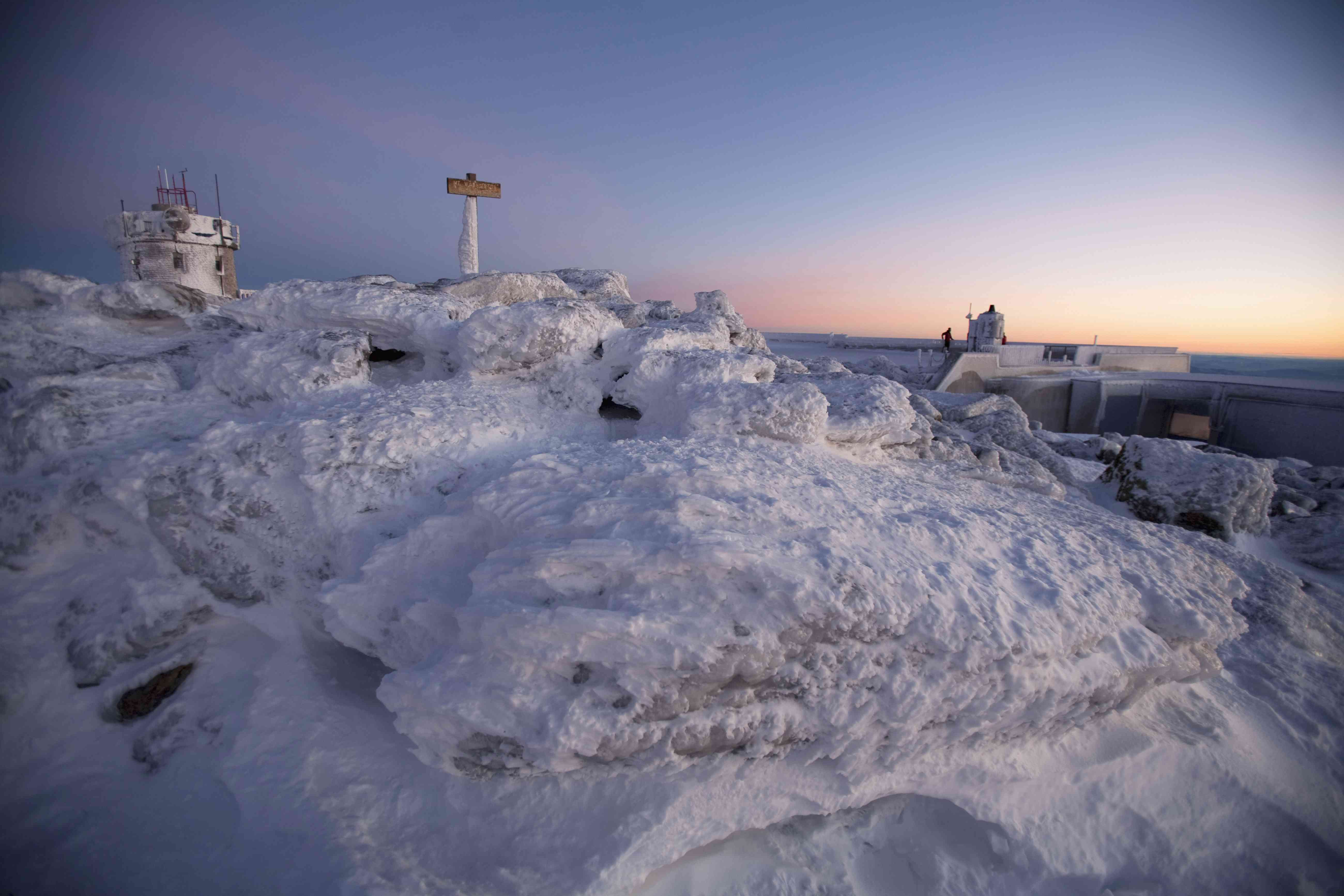 Sunrise on the summit of Mt. Washington, covered in snow