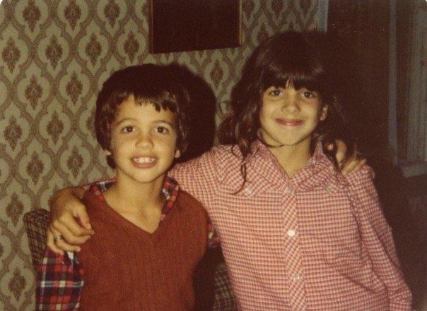 Siblings posing for the camera.