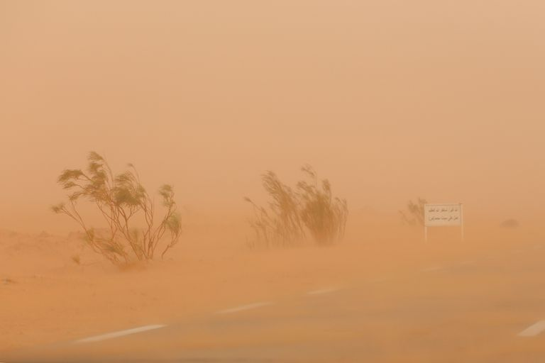 Hazy view of an African road during a dust storm.