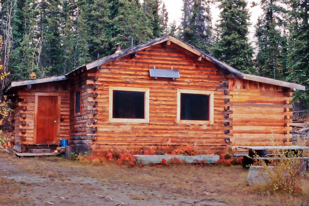 log cabin with solar panel