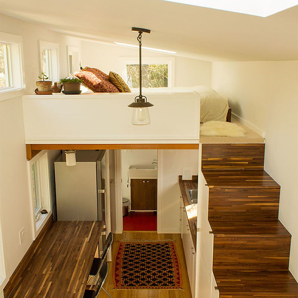 Staircase leading up to bedroom loft in tiny house