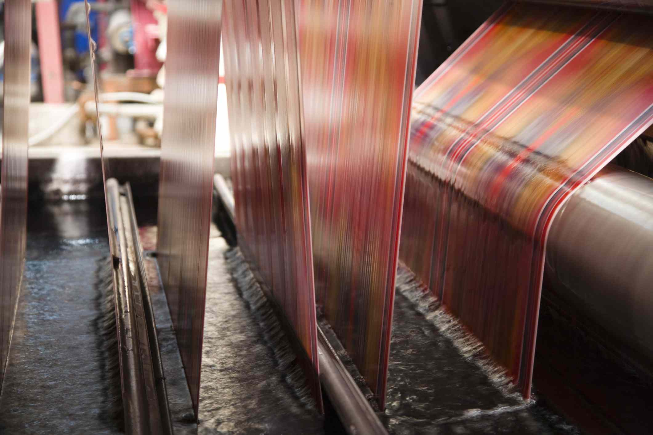 Synthetic fabrics being tased in factory